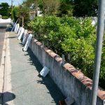 Pose clôture sur muret